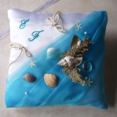 Coussin alliance la mer turquoise, coquillages